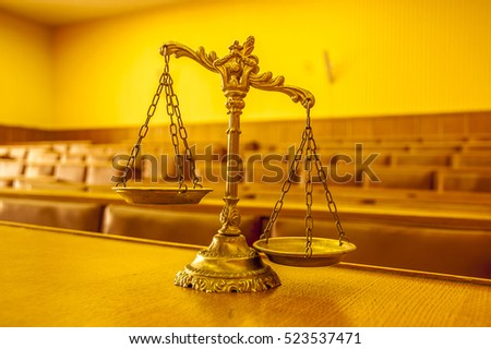 Scales of justice in the empty courtroom, law and justice concept, focus on the scales