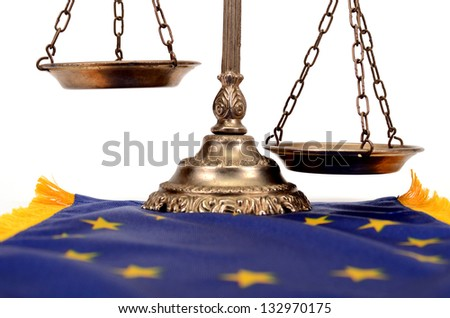 Scales of justice on the European Union flag, European Union law concept - stock photo