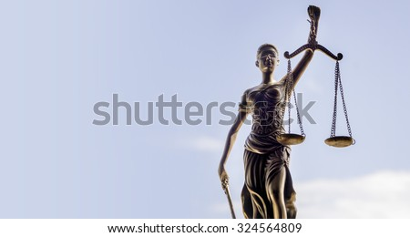 Scales of Justice symbol - legal law concept image. - stock photo