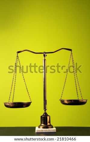 Scales over a bright green background - stock photo