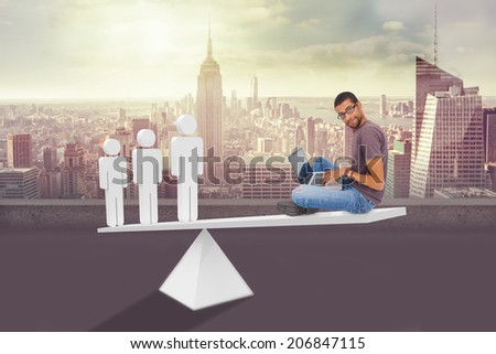 Scales weighing hip man using laptop and stick men against cityscape