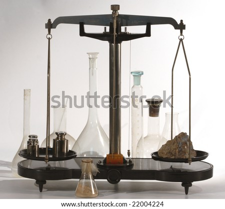 Scales, weights, a stone and old flasks - stock photo