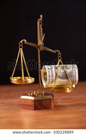 scales with money - stock photo