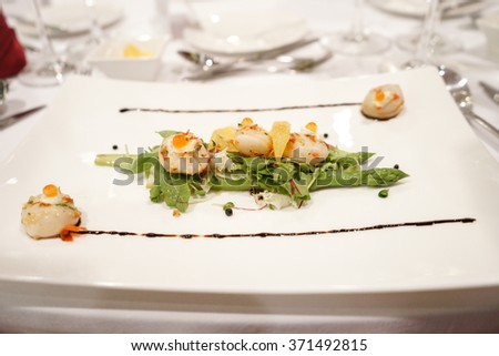 Scallop ceviche on fennel orange salad and marinated asparagus - stock photo
