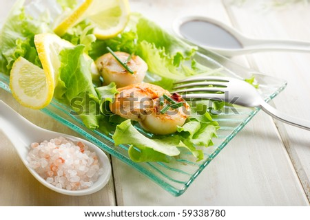 scallop with green salad - stock photo