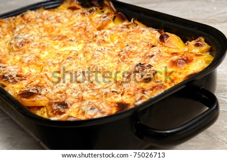 scalloped potatoes in the pan - stock photo