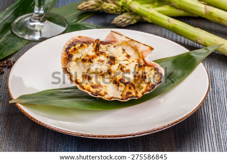 Scallops baked with cheese - stock photo