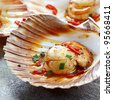 Scallops in the shell, cooked with chili.  Delicious! - stock photo