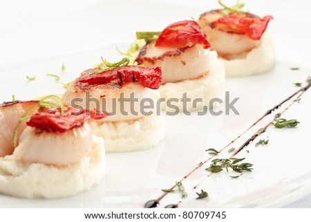 Scallops on a plate decorated on a white background - stock photo