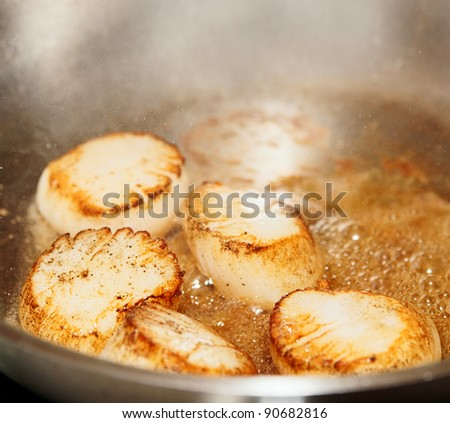 Scallops on hot  steel pan, close-up shot