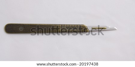 Scalpel blade on handle - stock photo