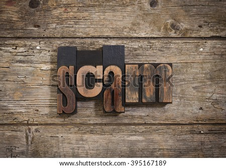 scam, single word set with vintage letterpress printing blocks on rustic wooden background - stock photo