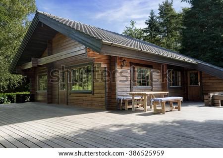 scandinavian cottage wooden house - stock photo