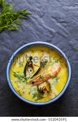 Scandinavian creamy fish soup with halibut, prawns and mussels