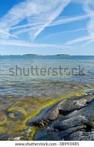 Scandinavian rocky coastline. Baltic Sea in summer. - stock photo