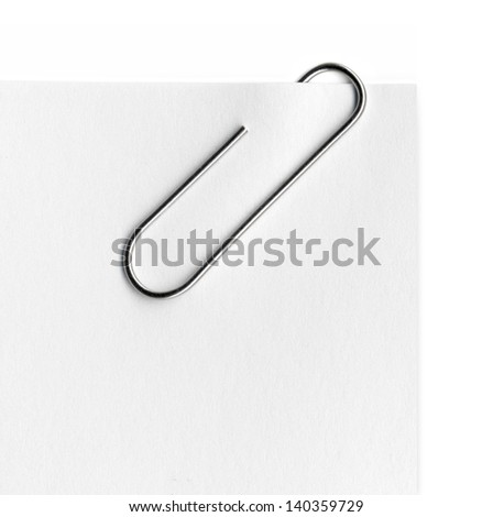 Scanned metal paper clip and paper on white background. - stock photo