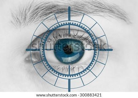 Scanner on blue human eye - stock photo