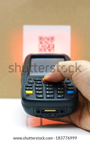 scanning QR code  label on the carton with laser - stock photo