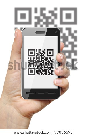 Scanning QR code with mobile phone on white background - stock photo