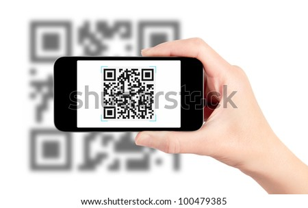 Scanning quick response code pattern with mobile smartphone. Isolated on white. - stock photo