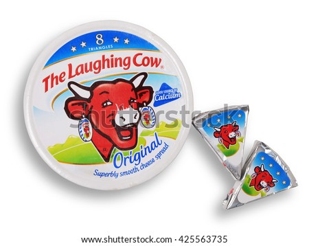 Scarborough, UK - February 16th, 2016: Pack of Laughing Cow spread cheese shot from above isolated on white with path. Created in 1921, the first cheese spread packaged in individual foil portions