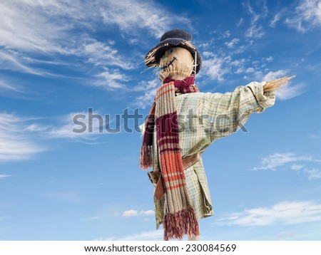 Scarecrow against the blue sky - stock photo