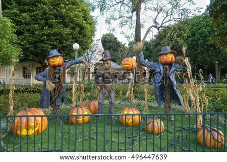 scarecrow and halloween pumpkin head jack o lantern statues for halloween decoration theme in an outdoor - Halloween Statues