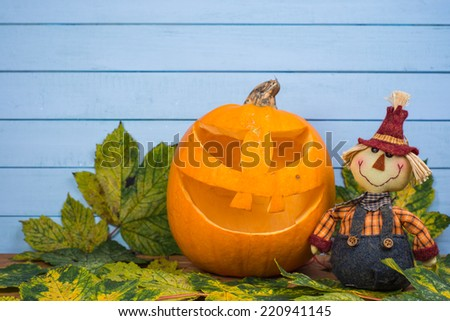 Scarecrow and natural Halloween pumpkin - stock photo