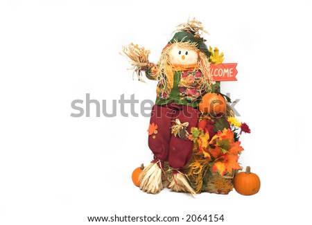 Scarecrow and pumpkins over white with copyspace available - stock photo