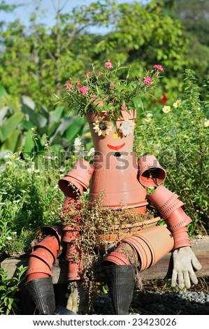Scarecrow made by flower pot