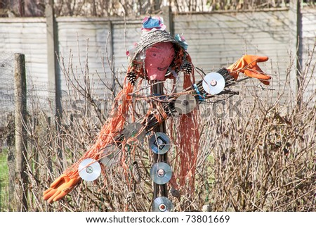 Scarecrow made ??from recycled materials - stock photo