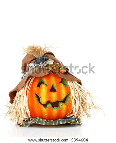Scarecrow Pumpkin Head - A jack o lantern pumpkin head wearing a hat and straw hair isolated on white with space for copy. - stock photo