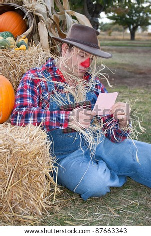 scarecrow with pink slip - stock photo