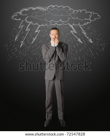 scared asian businessman in suit, bite his nails - stock photo