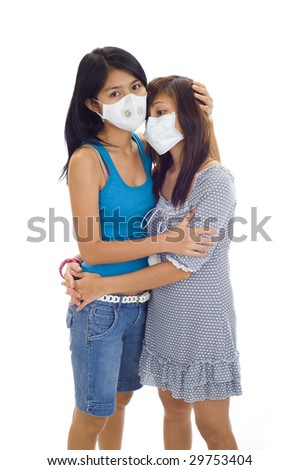 scared asian women with protective masks, isolated on white - stock photo