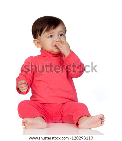 Scared baby girl with her hand in mouth sitting isolated on white background - stock photo