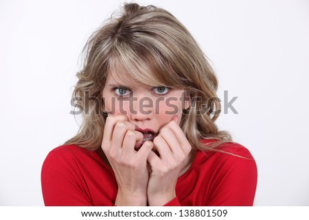 Scared blond woman - stock photo
