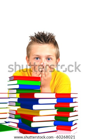 scared boy from school with books in foreground - stock photo