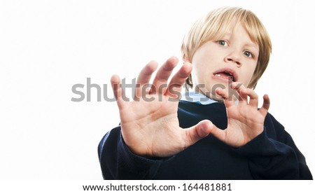 Scared boy isolated against white - stock photo
