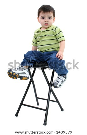 Scared boy on stool with scared or upset expression. Full body isolated over white. Clipping path.