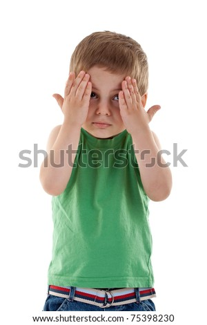 scared boy with his hands covering the eyes on a white background - stock photo