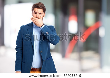scared businessman covering mouth - stock photo