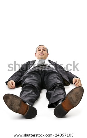 Scared businessman laying down in a suit isolated on white background - stock photo