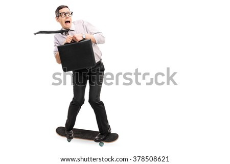 Scared businessman riding a skateboard and moving fast isolated on white background - stock photo