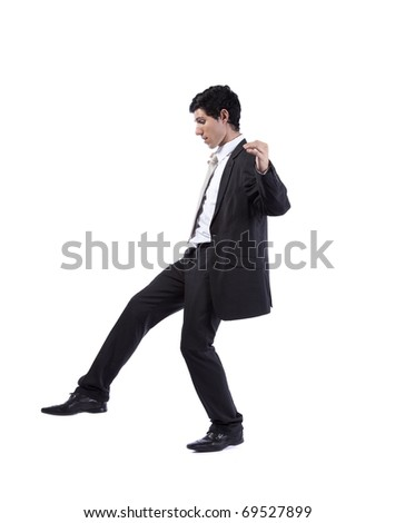 Scared businessman walking step by step (isolated on white) - stock photo
