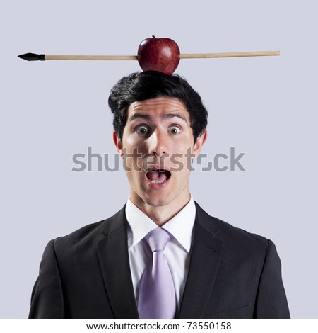 Scared businessman with a apple and arrow over his head - stock photo