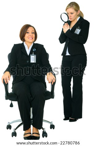 scared caucasian businesswoman under watch by other business investigator - stock photo