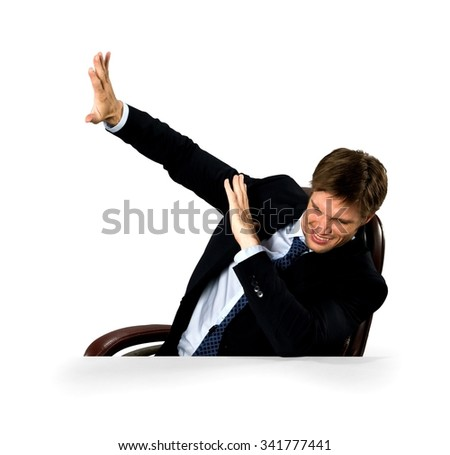 Scared Caucasian man with short medium blond hair in business formal outfit defending with body - Isolated