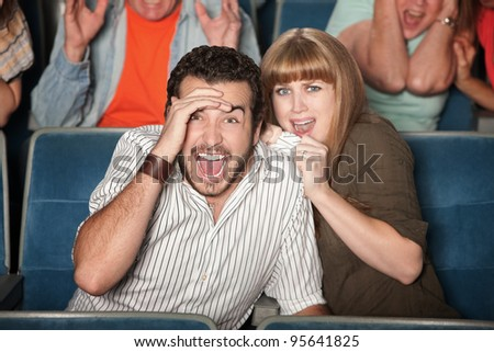 Scared couple screaming out loud watch horror movie - stock photo