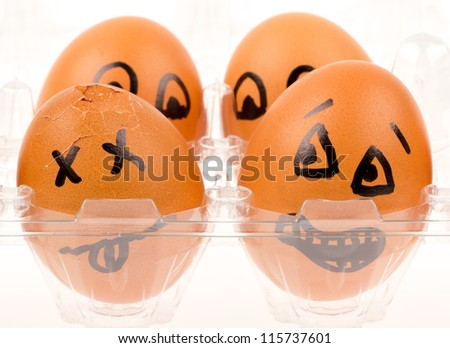 Scared egg is looking at it's dead neighbor, isolated on white - stock photo